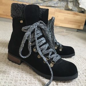 Women's black lace up winter boots.